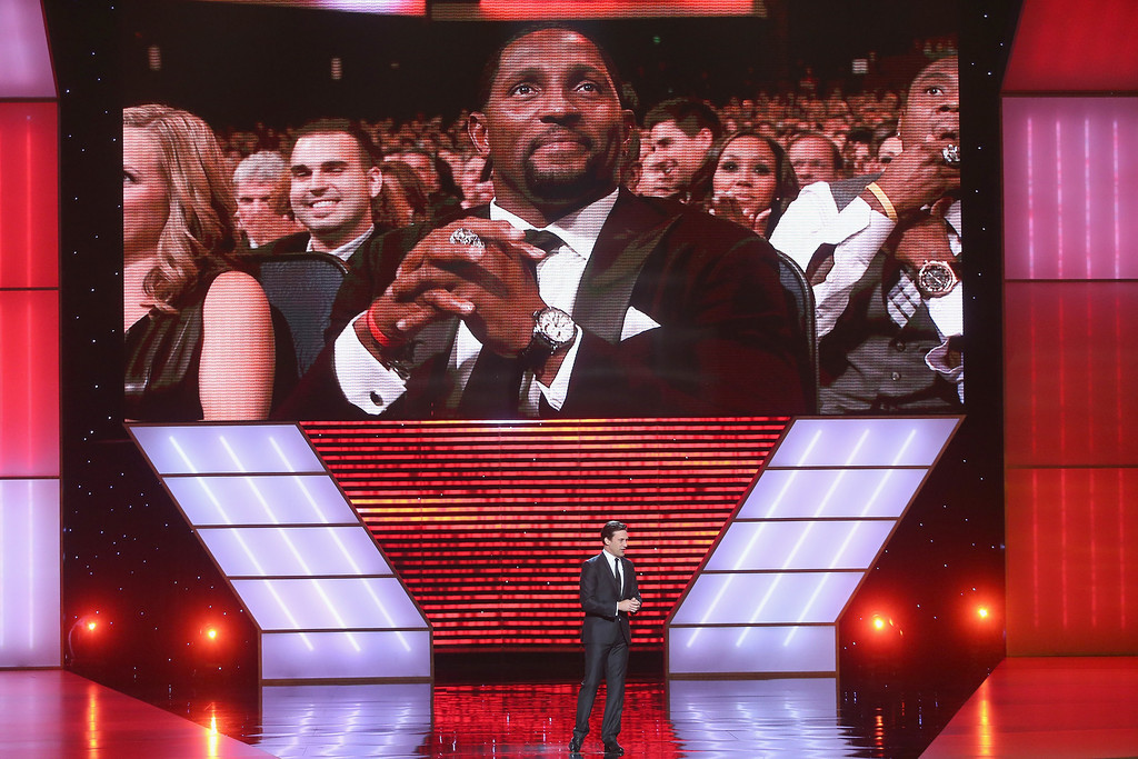. Above NFL player Ray Lewis is listening to Host Jon Hamm speak onstage at The 2013 ESPY Awards at Nokia Theatre L.A. Live on July 17, 2013 in Los Angeles, California.  (Photo by Frederick M. Brown/Getty Images for ESPY)