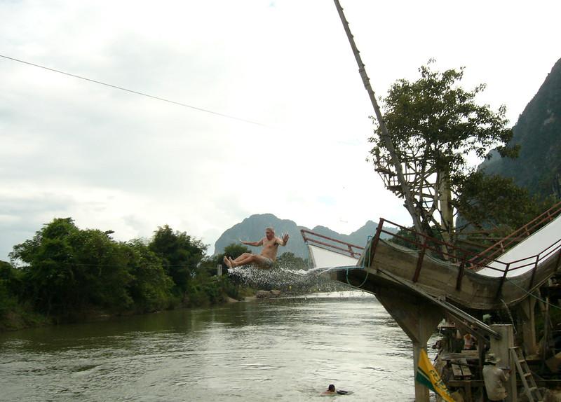 Keith goes off a big waterslide in Vang Vieng, Laos.