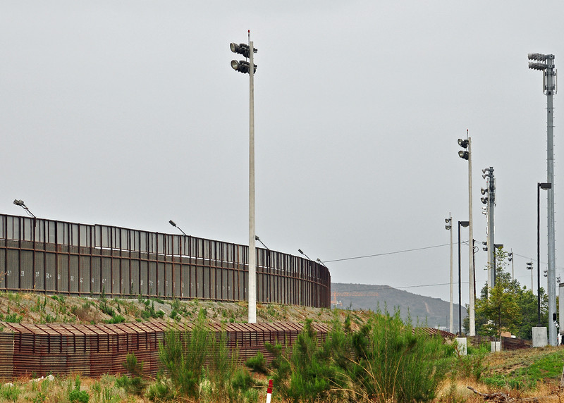 Two fences, lights, a moat and Border Patrol on bicycles...