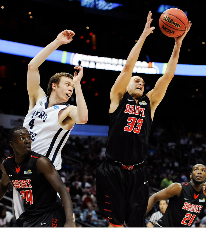 . Drury guard Alex Hall (33) rebounds against Metro State center Nicholas Kay (4) during the second half of the NCAA Division ll national championship college basketball game, Sunday, April 7, 2013, in Atlanta. Drury won 74-73. (AP Photo/John Amis)