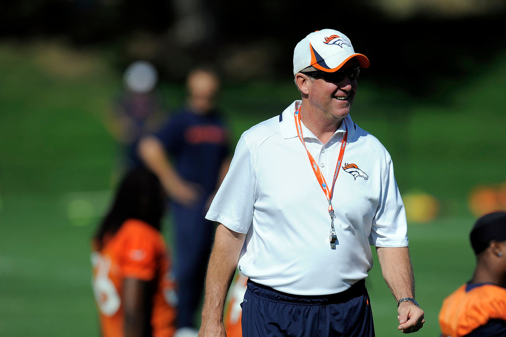 . Denver Broncos head coach John Fox smiles duirng the stretching portion of practice  September 9, 2013 at Dove Valley. (Photo by John Leyba/The Denver Post)