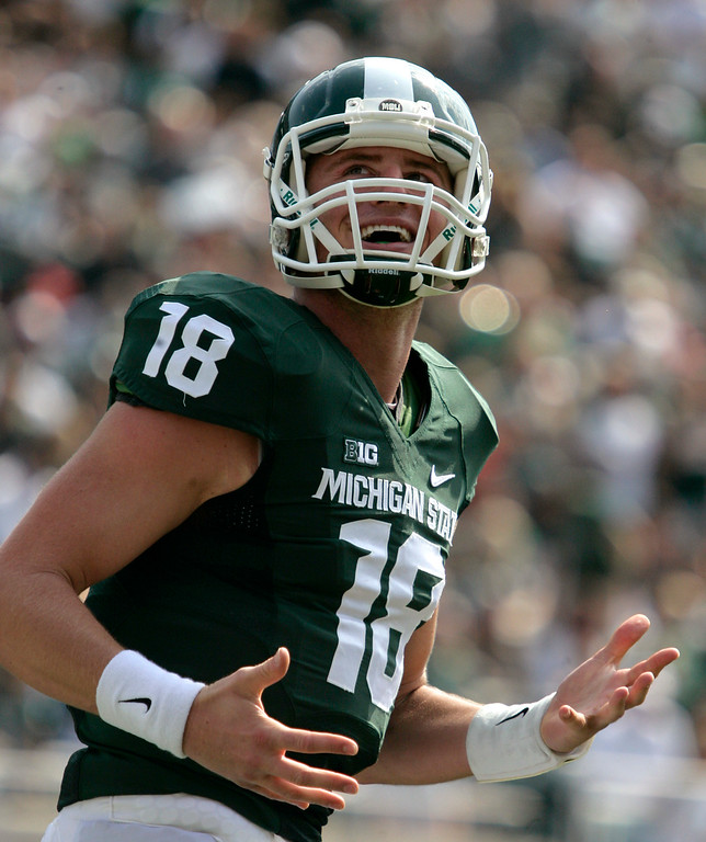 . Michigan State quarterback Connor Cook celebrates after a first-quarter touchdown against Eastern Michigan during an NCAA college football game, Saturday, Sept. 20, 2014, in East Lansing, Mich. Michigan State won 73-14. (AP Photo/Al Goldis)