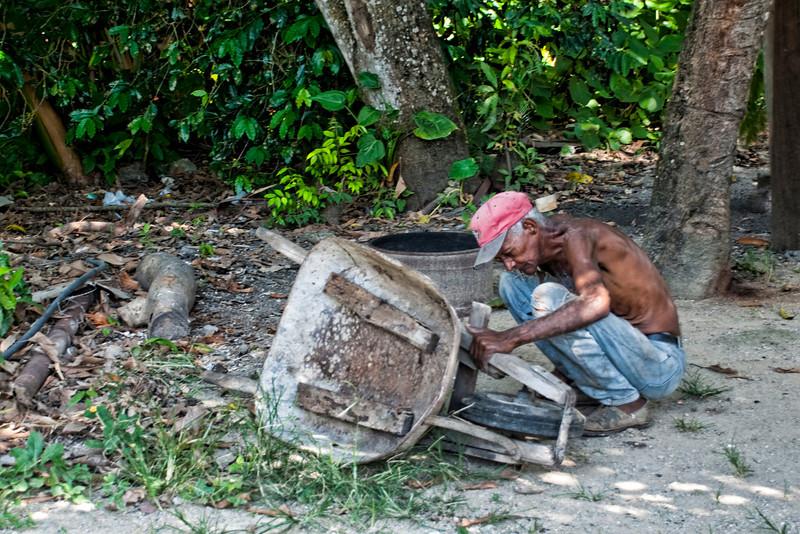 Repairing the wheelbarrel.