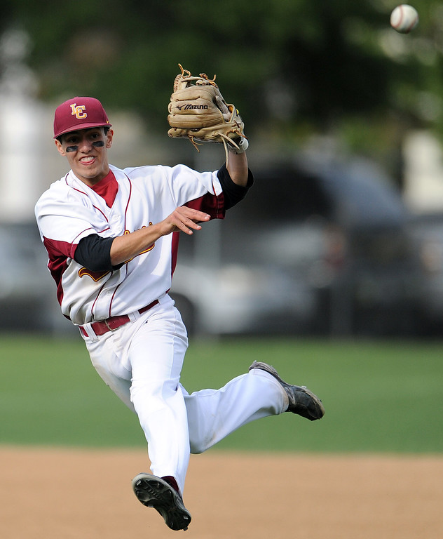 . La Canada shortstop Clayton Herrmann (C) throws out California\'s Daniel Marquez (not pictured) in the sixth inning of a CIF-SS playoff baseball game at La Canada High School on Thursday, May 16, 2013 in La Canada, Calif. La Canada won 4-2.  (Keith Birmingham Pasadena Star-News)