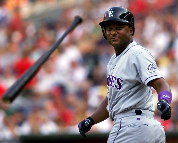 . Colorado Rockies\' Darryl Hamilton tosses his bat as he heads to first after being hit by a pitch from Cincinnati Reds pitcher Ron Villone in the first inning Friday, July 16, 1999, in Cincinnati. (AP Photo/Al Behrman)