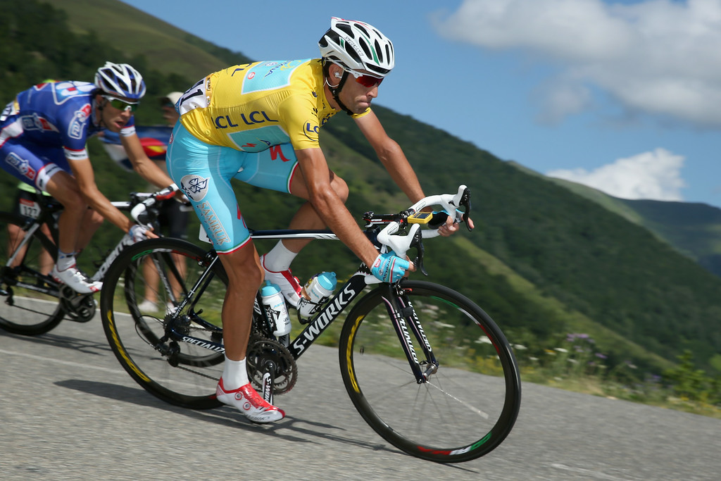 . Vincenzo Nibali of Italy and the Astana Pro Team descends the Port de Bales as he defends the overall race leader\'s yellow jersey during the sixteenth stage of the 2014 Tour de France, a 238km stage between Carcassonne and Bagneres-de-Luchon, on July 22, 2014 in Bourg d\'Oueil, France. Nibali if followed by Thibaut Pinot of France and FDJ.fr who earned the best young rider\'s white jersey in the stage.  (Photo by Doug Pensinger/Getty Images)