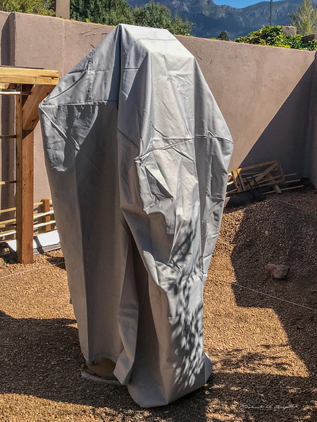 During the day the mount (telescope removed) is covered by two plastic bags, a space blanket, and a waterproof swamp cooler cover.  Here we see the swamp cooler cover for overall protection from the weather.