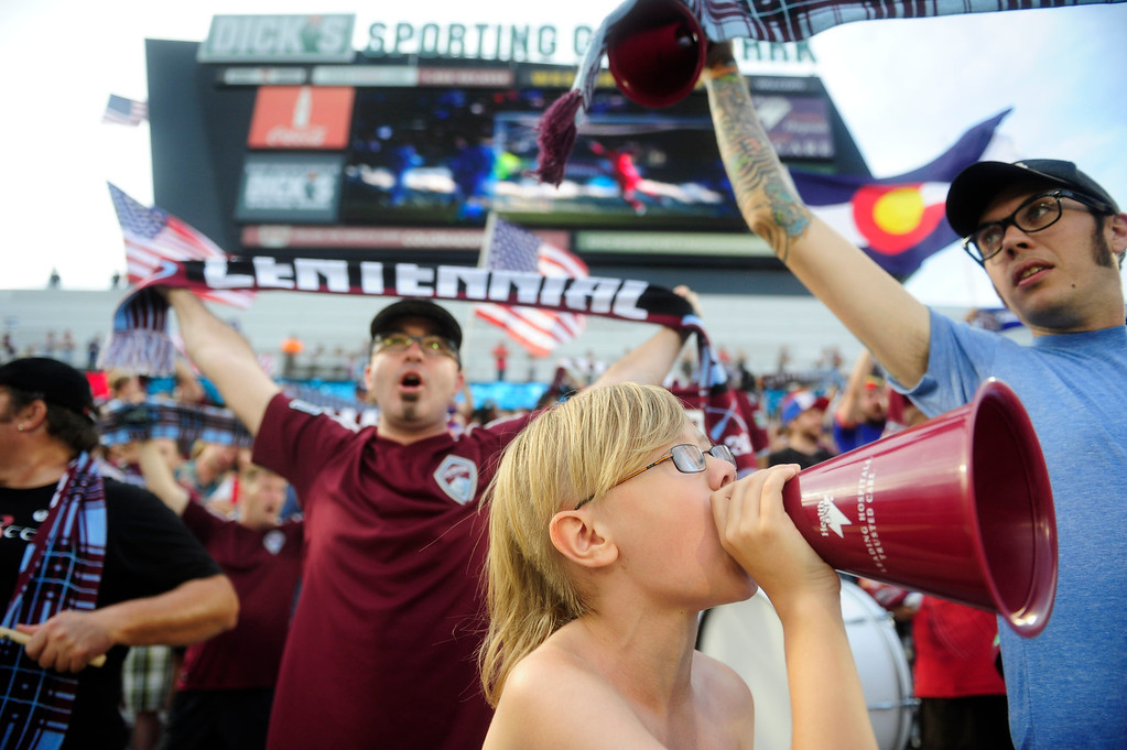 . DENVER - JULY 4:  Mason Bennett cheers for the Colorado Rapids with his father Nathan, right, before the first half of a MLS soccer match between the Colorado Rapids and the New York Red Bulls on July 4, 2013 at Dick\'s Sporting Goods Park. The Rapids defeated the Red Bulls 2-0. (Photo By Grant Hindsley / The Denver Post)