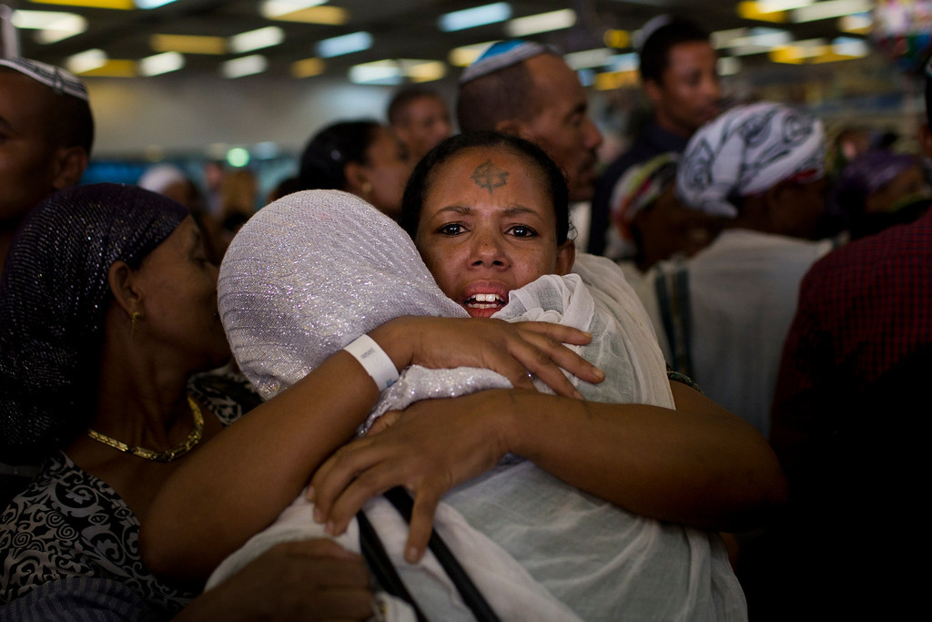 . A new Jewish immigrant from Ethiopia is welcomed by a family member at the Ben Gurion airport near Tel Aviv, Israel, Wednesday, Aug. 28, 2013. Israeli authorities have completed what they say is the final large airlift of Ethiopian immigrants, culminating decades of efforts to bring in the remnants of an ancient community to the Jewish state. (AP/Bernat Armangue)