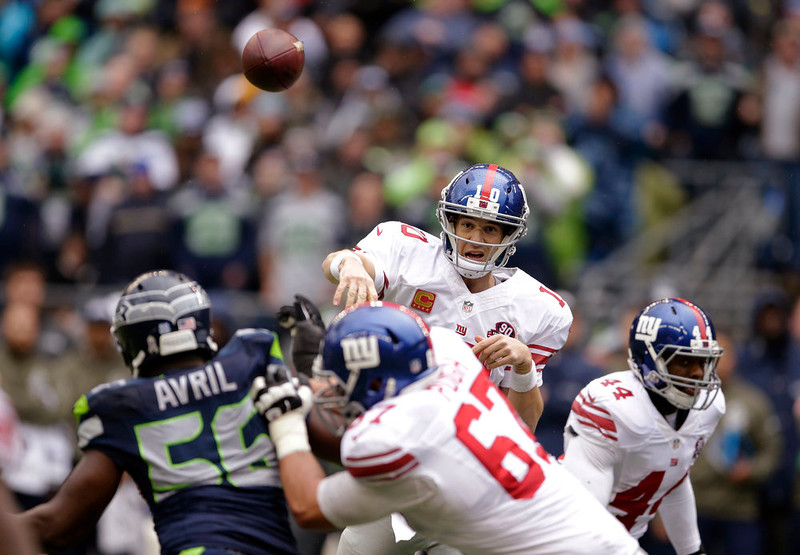 . New York Giants quarterback Eli Manning passes against the Seattle Seahawks during the first half of an NFL football game, Sunday, Nov. 9, 2014, in Seattle. (AP Photo/Scott Eklund)