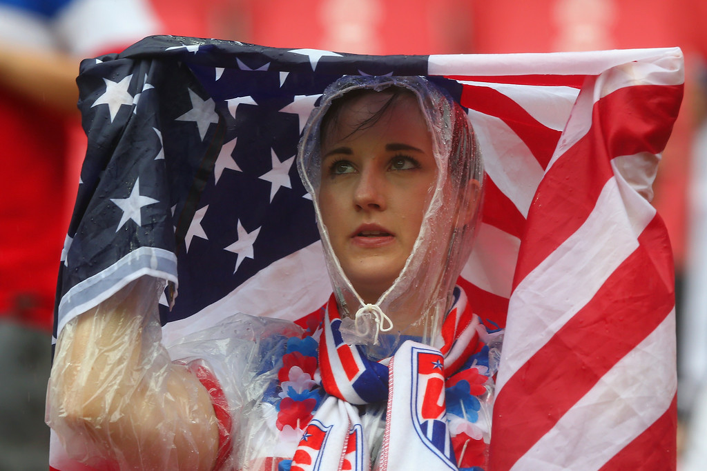 . An United States fan looks on in the rain prior to the 2014 FIFA World Cup Brazil group G match between the United States and Germany at Arena Pernambuco on June 26, 2014 in Recife, Brazil.  (Photo by Martin Rose/Getty Images)