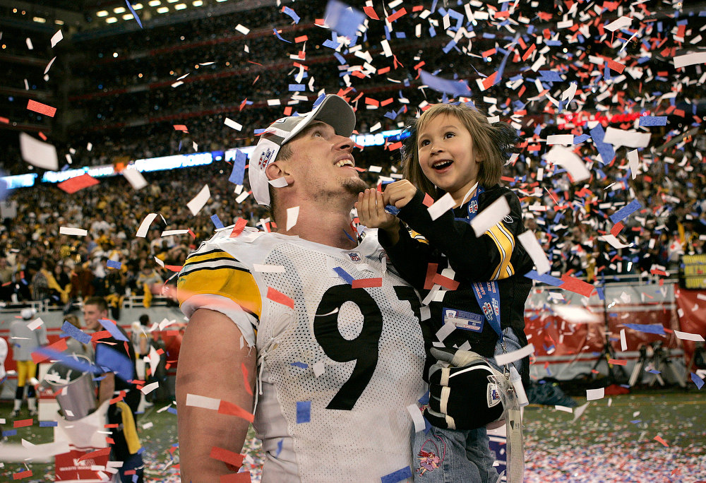 Description of . Aaron Smith of the Pittsburgh Steelers celebrates after winning Super Bowl XL Between the Pittsburgh Steelers and the Seattle Seahawks at Ford Field in Detoit, Michigan on February 5, 2006. (Photo by G. N. Lowrance/Getty Images/NFLPhotoLibrary)