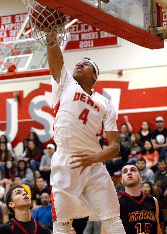 . Pasadena\'s Tyrek Adams (4) slam dunks against Ontario in the first half of a prep playoff game at Pasadena High School in Pasadena, Calif., on Friday, Feb.21, 2014. (Keith Birmingham Pasadena Star-News)