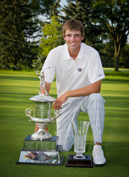 Chris Williams, 20, of Moscow, Idaho, with trophies for being the low medalist of stroke-play.