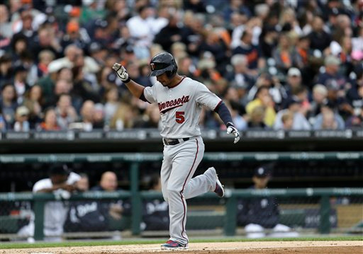 . Minnesota Twins\' Eduardo Escobar celebrates hitting a solo home run against the Detroit Tigers in the third inning of a baseball game in Detroit, Friday, June 13, 2014.  (AP Photo/Paul Sancya)