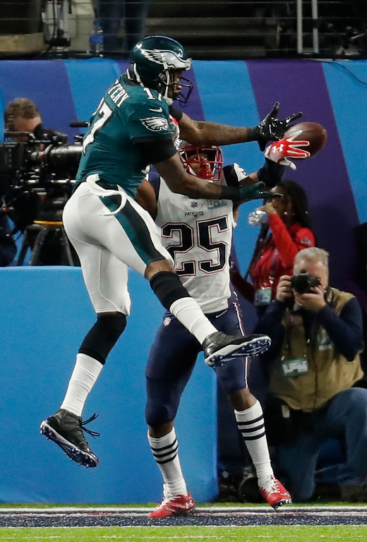 . New England Patriots cornerback Eric Rowe (25) breaks up a pass intended for Philadelphia Eagles wide receiver Alshon Jeffery (17), during the first half of the NFL Super Bowl 52 football game, Sunday, Feb. 4, 2018, in Minneapolis. (AP Photo/Charlie Neibergall)