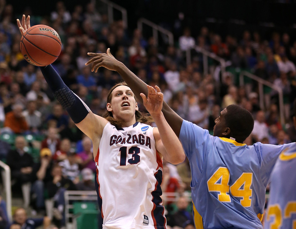 . SALT LAKE CITY, UT - MARCH 21:  Kelly Olynyk #13 of the Gonzaga Bulldogs goes up for a shot against Javan Mitchell #44 of the Southern University Jaguars in the second half during the second round of the 2013 NCAA Men\'s Basketball Tournament at EnergySolutions Arena on March 21, 2013 in Salt Lake City, Utah.  (Photo by Streeter Lecka/Getty Images)