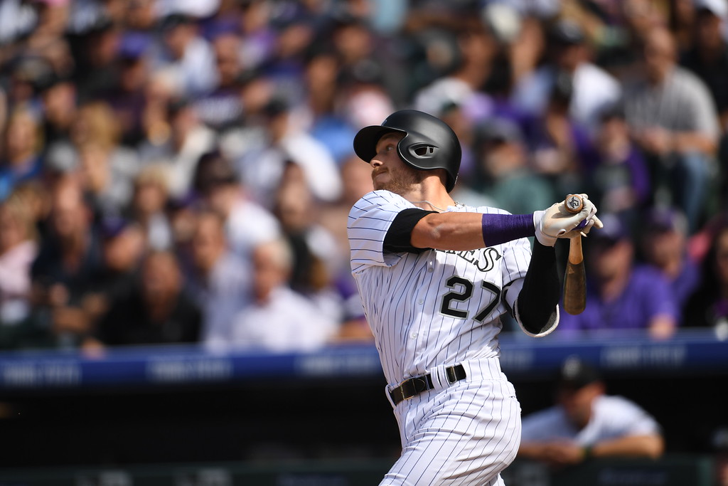 . Trevor Story (27) of the Colorado Rockies hits a single RBI during the second inning. The Colorado Rockies played the San Diego Padres Friday, April 8, 2016 on opening day at Coors Field in Denver, Colorado. (Photo By RJ Sangosti/The Denver Post)