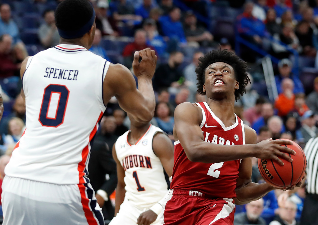. Alabama\'s Collin Sexton, right, heads to the basket as Auburn\'s Horace Spencer, left, defends during the second half in an NCAA college basketball quarterfinal game at the Southeastern Conference tournament Friday, March 9, 2018, in St. Louis. Alabama won 81-63. (AP Photo/Jeff Roberson)