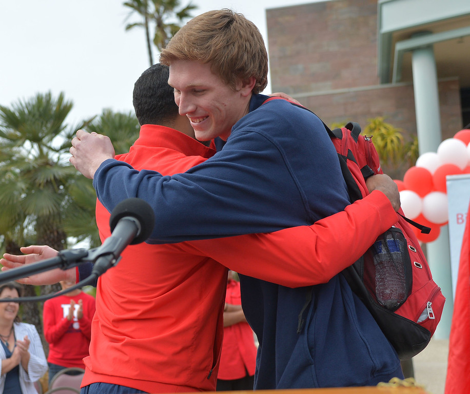 . TBR29-RUHS_PARADE--- Redondo Beach, CALIFORNIA--3/28/13--- Staff Photo: Robert Casillas / LANG---  The Redondo Union High basketball team was celebrated Thursday for their CIF State title. The festivities began with a double decker bus ride around the school and a rally at City Hall.