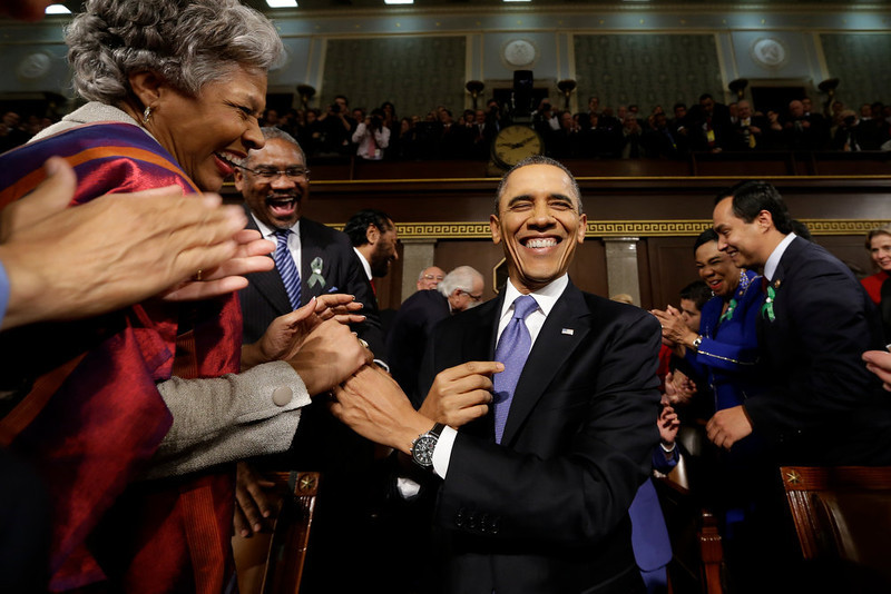 . U.S. President Barack Obama is greeted before his State of the Union address during a joint session of Congress on Capitol Hill on February 12, 2013 in Washington, D.C. Facing a divided Congress, Obama is expected to focus his speech on new initiatives designed to stimulate the U.S. economy. (Photo by Charles Dharapak-Pool/Getty Images)