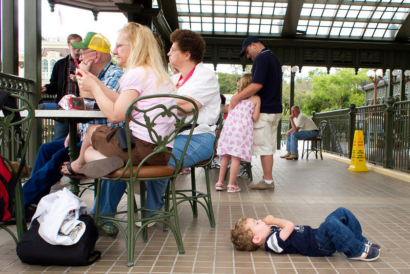 Ty, a bit tuckered out from his day at the park, decides to take a quick power-nap in the middle of the Disney train station.