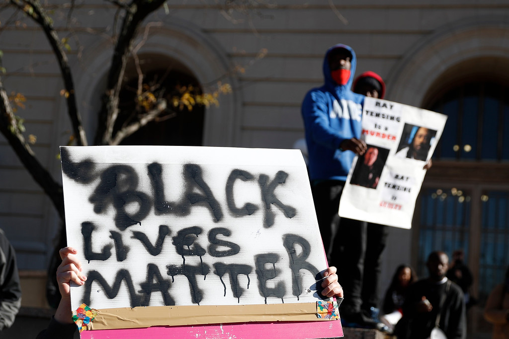 . Protestors gather outside the Hamilton County Courthouse after a mistrial is declared due to a hung jury in the murder trial against Ray Tensing, Saturday, Nov. 12, 2016, in Cincinnati. Tensing, the former University of Cincinnati police officer, is charged with murdering Sam DuBose while on duty during a routine traffic stop on July 19, 2015. (AP Photo/John Minchillo)