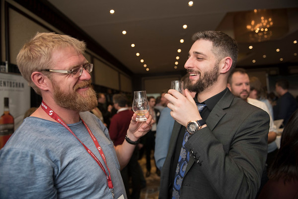 DAVID LIPNOWSKI / WINNIPEG FREE PRESS  Friends Justin Bender (left) and Brett Gladstone (right) take in the 2017 Winnipeg Whiskey Festival Friday March 3, 2017 at the Fairmont Hotel.