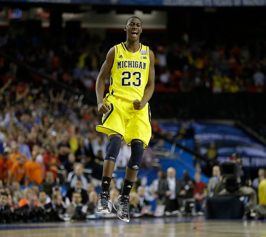 . Michigan\'s Caris LeVert (23) reacts during the second half of the NCAA Final Four tournament college basketball semifinal game against Syracuse, Saturday, April 6, 2013, in Atlanta. Michigan won 61-56. (AP Photo/Charlie Neibergall)