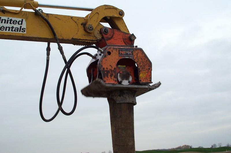 NPK C6C compactor on Deere backhoe-pile driving (3).jpg