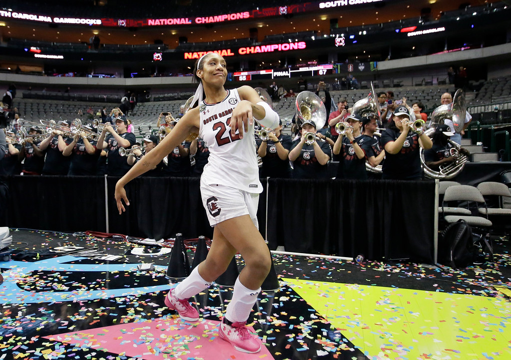 . South Carolina forward A\'ja Wilson (22) dances as the South Carolina band plays as they celebrate the team\'s win over Mississippi State the final of NCAA women\'s Final Four college basketball tournament, Sunday, April 2, 2017, in Dallas. South Carolina won 67-55. (AP Photo/LM Otero)