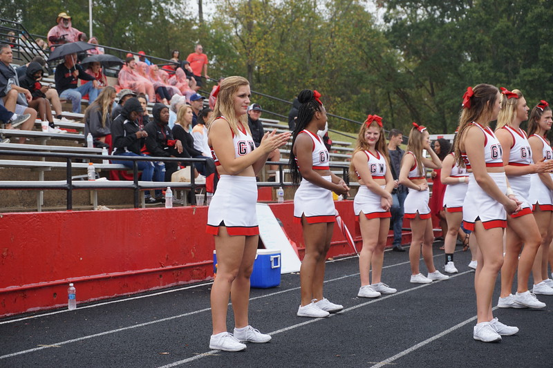 Haley Grace Lowman claps for the football team alongside the other cheerleaders.