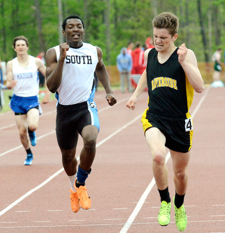 . Maribeth Joeright/MJoeright@News-Herald.com<p> Riverside\'s Brigham Baker edges out South\'s Robert Parker in the boys 400 meter run during the PAC meet, May 15, 2014.