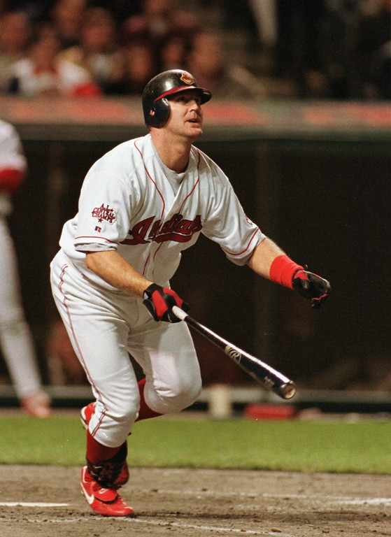 . Cleveland Indians slugger Jim Thome watches his sixth-inning home run clear the wall against the Oakland Athletics Tuesday, April 20, 1999,  in Cleveland. The Indians beat Oakland 5-1 to go to 10-2 on the season. (AP Photo/Ron Schwane)