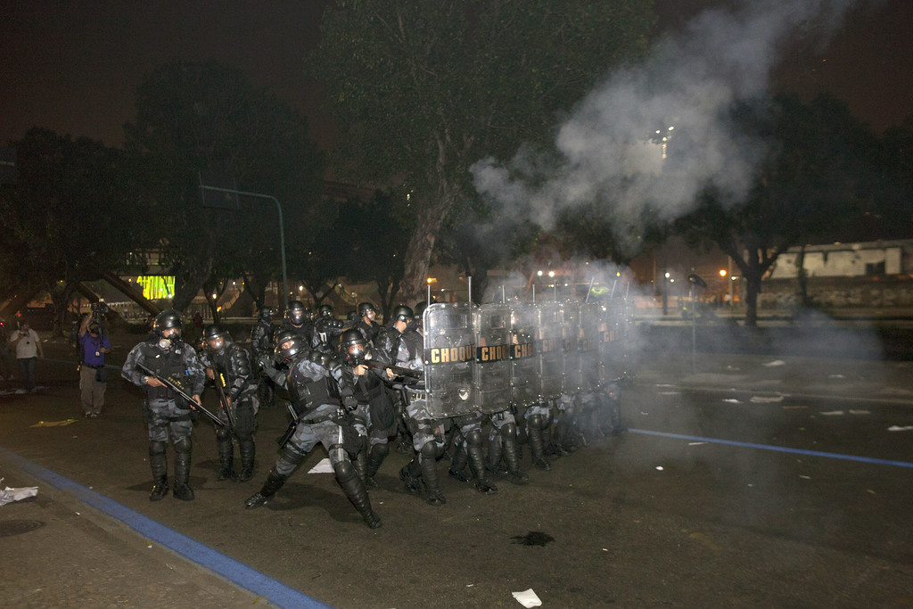. Anti riot police officers fire rubber bullets after clashes erupted during a protest against bus fare price hikes June 20, 2013 in Rio de Janeiro, Brazil.  (Photo by Rafael S. Fabres/Getty Images)
