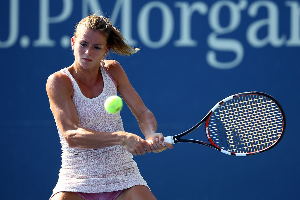 . NEW YORK, NY - AUGUST 25:  Camila Giorgi of Italy returns a shot against Anastasia Rodionova of Australia during her women\'s singles round one match on Day One of the 2014 US Open at the USTA Billie Jean King National Tennis Center on August 25, 2014  in the Flushing neighborhood of the Queens borough of New York City.  (Photo by Al Bello/Getty Images)