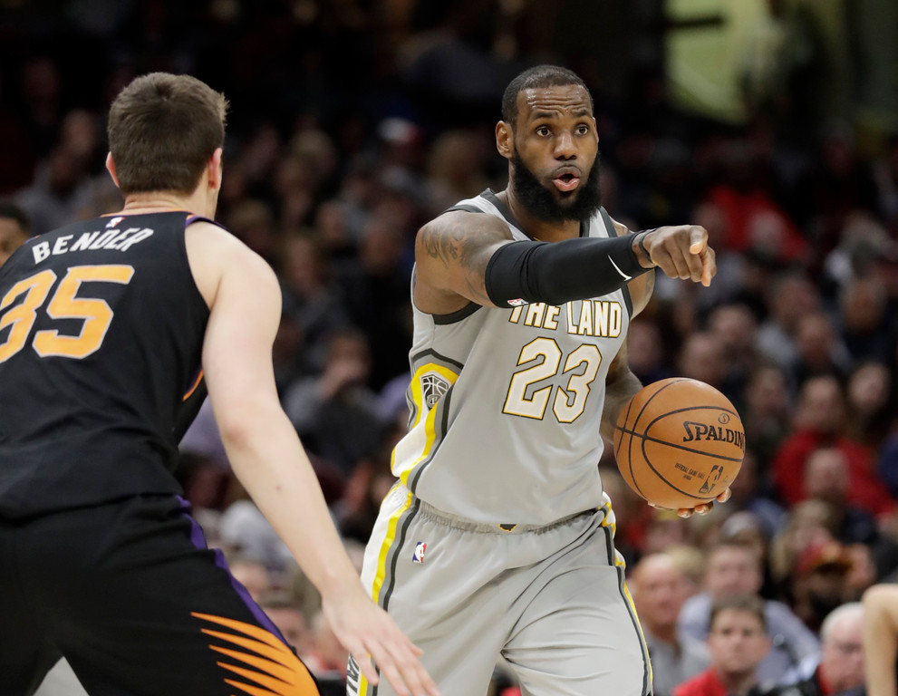 . Cleveland Cavaliers\' LeBron James (23) points to a teammate against Phoenix Suns\' Dragan Bender (35) in the second half of an NBA basketball game, Friday, March 23, 2018, in Cleveland. (AP Photo/Tony Dejak)