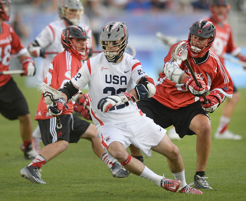 . United States midfielder Ned Crotty (22) worked with the ball in the first quarter. The United States took on Canada in the opening game of the FIL World Lacrosse Championships Thursday night, July 10, 2014.   Photo by Karl Gehring/The Denver Post