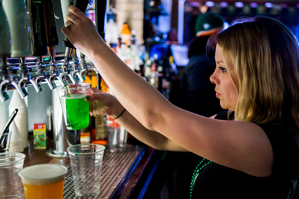 . Bartender Rachel Zehnder pours a green beer from the tap on St. Patrick\'s Day on Tuesday, March 17, 2015  in downtown Flint, Mich.  (AP Photo/The Flint Journal-MLive.com, Jake May)