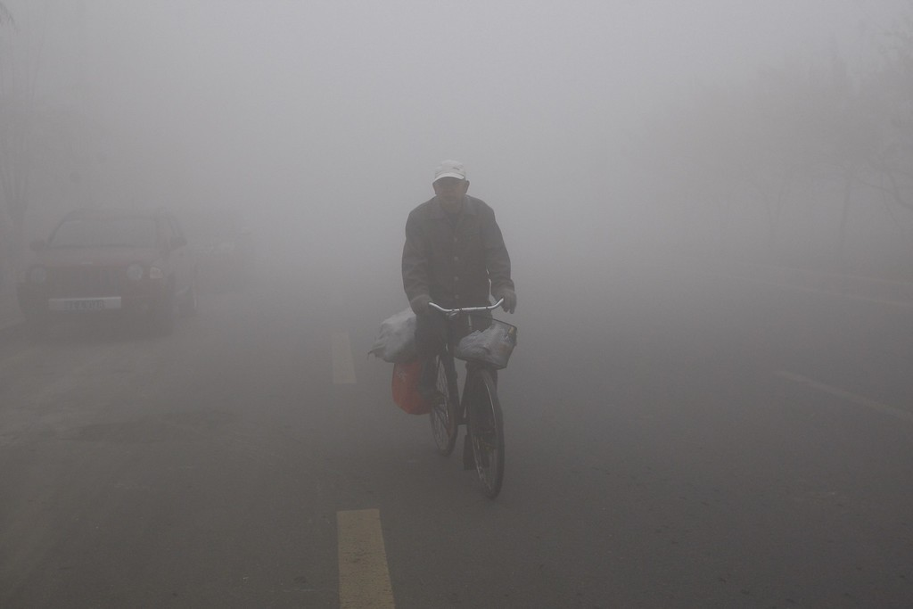 . A man cycles in the smog in Harbin, northeast China\'s Heilongjiang province, on October 21, 2013.    AFP PHOTOSTR/AFP/Getty Images