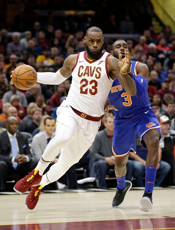. Cleveland Cavaliers\' LeBron James (23) drives past New York Knicks\' Tim Hardaway Jr. (3) in the first half of an NBA basketball game, Sunday, Oct. 29, 2017, in Cleveland. (AP Photo/Tony Dejak)
