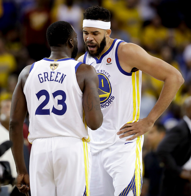 . Golden State Warriors forward Draymond Green (23) talks with center JaVale McGee (1) during the second half of Game 1 of basketball\'s NBA Finals against the Cleveland Cavaliers in Oakland, Calif., Thursday, May 31, 2018. (AP Photo/Marcio Jose Sanchez)