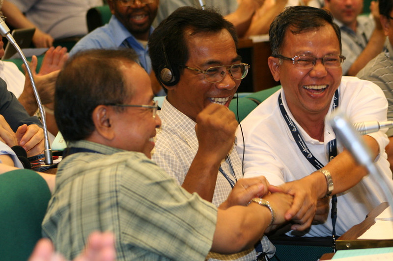 Fr. Sugino (green shirt) receives congratulations from fellow Indonesians after he accepts his election the General Council.