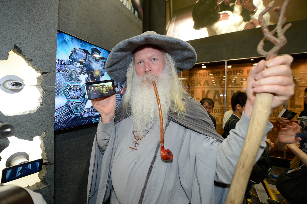 . An LG Optimus G Pro is beheld by a Comic-Con attendee dressed as Gandalf at the Legendary Entertainment booth at Comic-Con International 2013, on Thursday, July, 18, 2013 in San Diego. (Photo by Jeff Bottari/Invision for LG/AP Images)