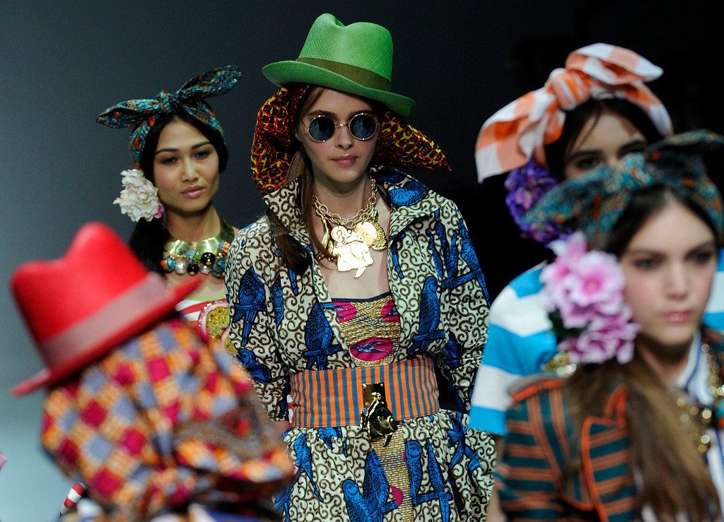 . Models wear creations for Stella Jean\'s women\'s Spring-Summer 2014 collection, part of the Milan Fashion Week, unveiled in Milan, Italy, Saturday, Sept. 21, 2013. (AP Photo/Giuseppe Aresu)