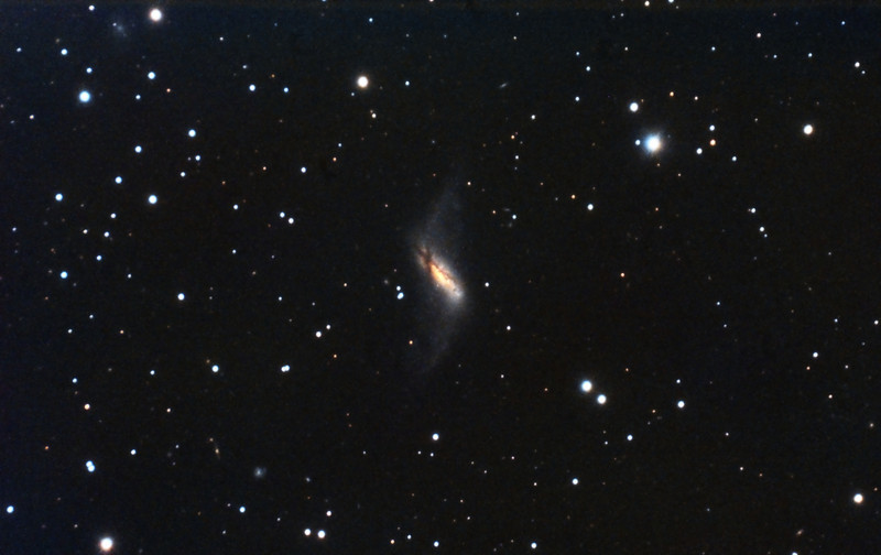 """NGC660: Polar Ring Galaxy in Pisces, 34 x 10 minutes, F/10, 12/17/2011. Celestron 8"""" EdgeHD with Astro-Physics Mach1GTO GEM. SXVR-M25C. IDAS LPS Filter. Hutech OAG. Lodestar. Pre-Processed (BPM, Bias, Flats Calibration and Debayer) with Nebulosity. Post-processed with PixInsight. PHD settings: RA Aggressiveness: 90, RA Hysteresis: 10, Max Dec Duration: 50, Min Motion: 0.30, Calibration Steps: 100msec, Auto/Resist Switching, No Dithering, 0.5 sec guiding exposure."""