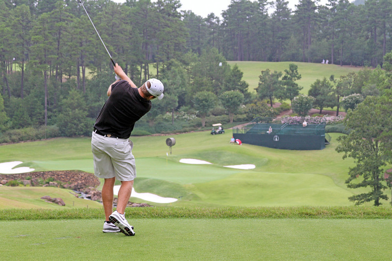 Steven Ihm of Peosta, IA sends a tee shot towards the 16th green during the opening round of the 111th Western Amateur at The Alotian Club in Roland, AR. (WGA Photo/Ian Yelton)