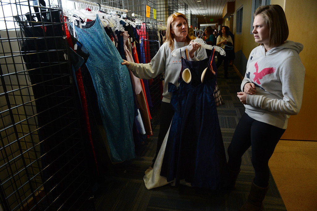 """. COMMERCE CITY, CO. - MARCH 16: Jordan Beeson, a freshman at Faith Christian Academy, reacts to a dress while shopping with her mother, Lisa, at the Prom Dress Exchange Corp. event in Commerce City, CO March 16, 2013. With a valid student ID and a suggested $10 donation, teenage girls could chose from 1,356 donated dresses that lined a long hallway at Dick�s Sporting Goods Park. Lisa said, \""""I think it\'s amazing... to have an opportunity to not break the bank for a one night event. That\'s awesome.\""""(Photo By Craig F. Walker/The Denver Post)"""