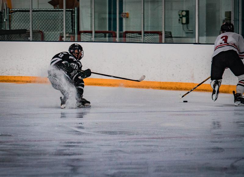 Holy Family Boys Varsity Hockey vs. Elk River, 12/27/19: Charlie Lindberg '21 (10)