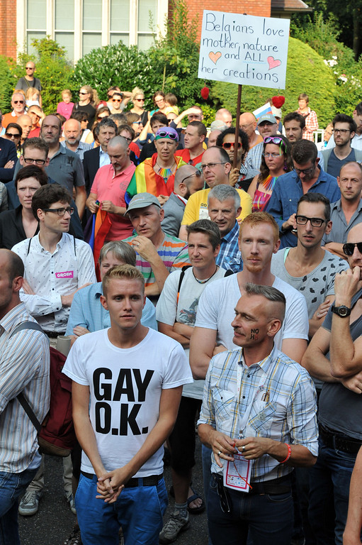 ". more than 300 gay and lesbian supporters participate in a  \'Kiss-In\' action at the Russian consulate in Antwerp to protest against the treatment of lesbian, gay, bisexual and transgender oriented people in Russia on August 9, 2013.  Russia on Friday said it was unperturbed by threats of an Olympic boycott over a controversial law banning ""homosexual propaganda\"", despite wide-ranging criticism of the legislation from athletes to US President Barack Obama. GEORGES GOBET/AFP/Getty Images"